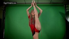 Horny Red Dressed Gymnast Doing Spreads Thumb