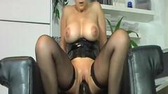 Busty milf bounces on her huge dildo Thumb