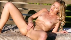 Watch Lena Nicole pleasing her pussy in the sunshine Thumb