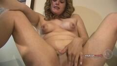 Sensual babe rubs her warm slot Thumb