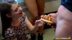 Kinky Alice March slurps on hot dog cock bun Thumb